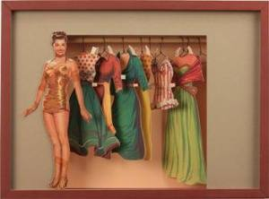 A treasured paper doll turned into an awesome shadow box.